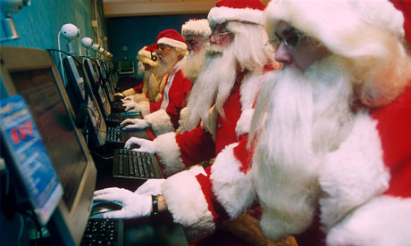 Santas on computers at Virgin Megastore